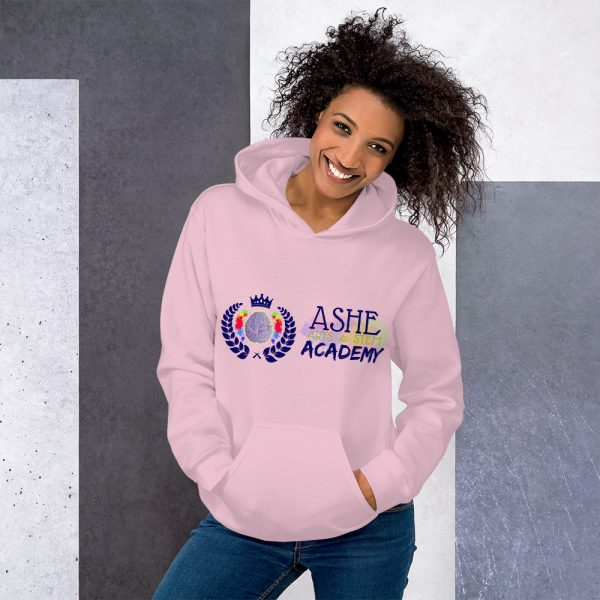Woman wearing Light Pink Inspire Uplift Engage Hoodie standing at an angle front view The Ashe Academy Store