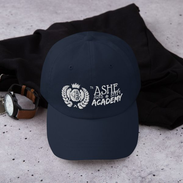 Navy Ballcap sitting in front of hoodie and next to watch The Ashe Academy Store