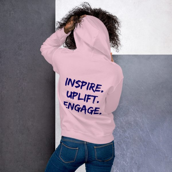 Woman wearing Light Pink Inspire Uplift Engage Hoodie back view The Ashe Academy Store