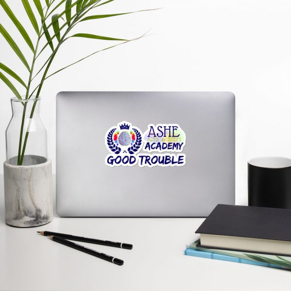 5.5x5.5 Good Trouble Sticker on laptop next to vase The Ashe Academy Store