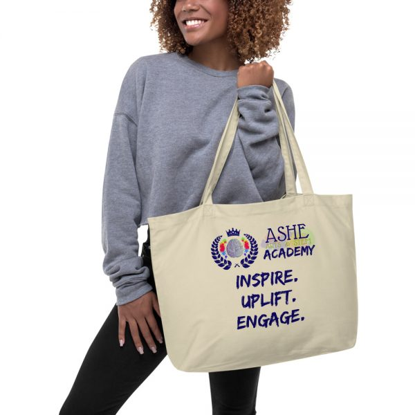Woman holding Tan Tote Bag The Ashe Academy Store