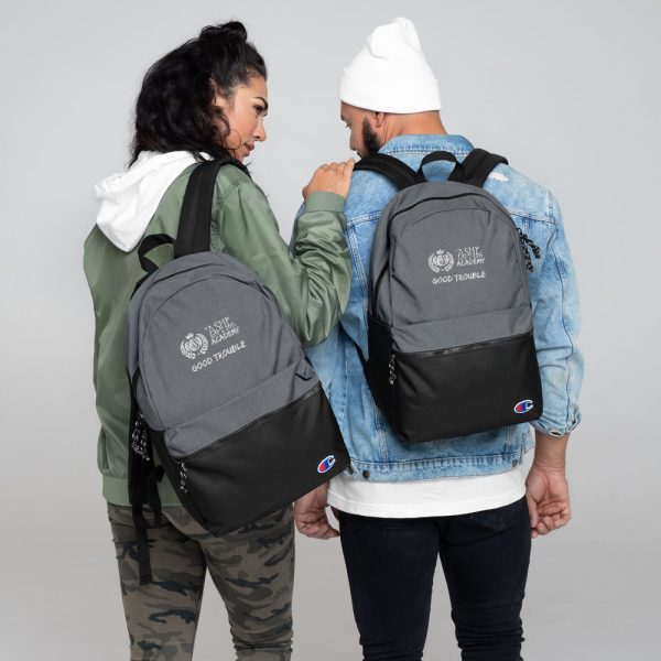 Man and Woman wearing Heather Grey / Black Good Trouble Backpack The Ashe Academy Store