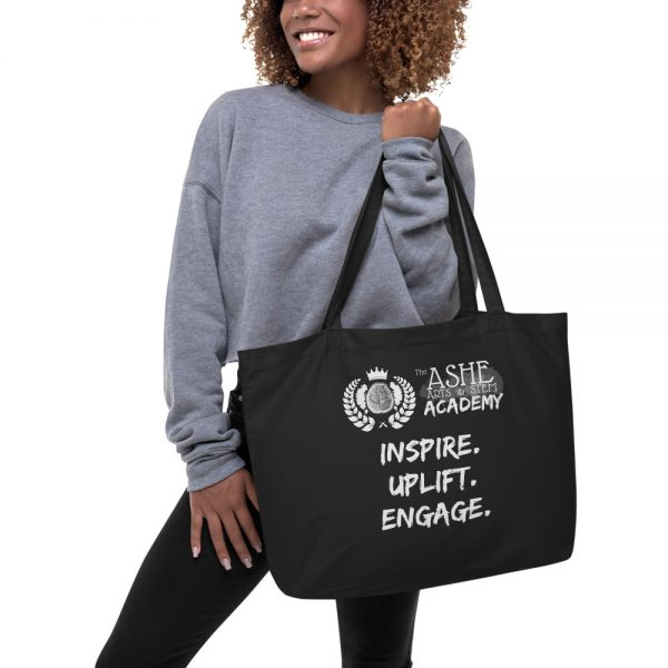 Woman holding Black Tote Bag The Ashe Academy Store