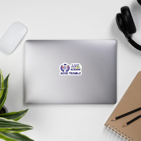 3x3 Good Trouble Sticker on laptop next to headphones The Ashe Academy Store