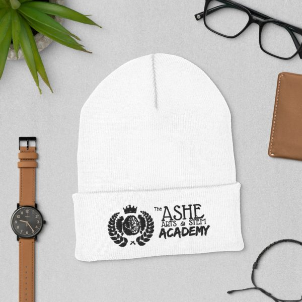 White Beanie laying down next to watch and eyeglasses The Ashe Academy Store