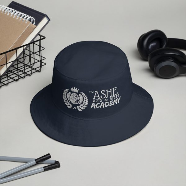 Navy Bucket Hat sitting next to headphones and pens The Ashe Acdemy Store