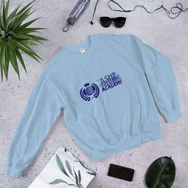 Light Blue Sweatshirt laying down next to phone and sun glasses front view The Ashe Academy Store