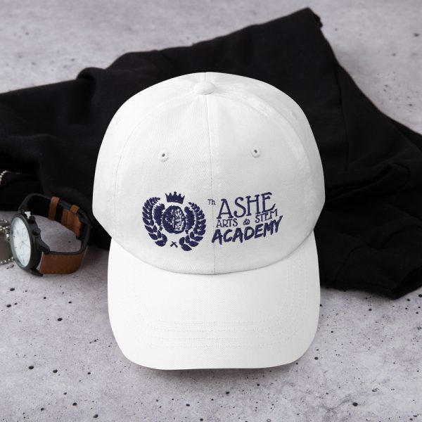 White Ballcap sitting in front of hoodie and next to watch The Ashe Academy Store